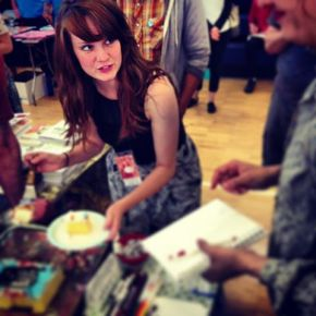 Guild Master Kyla Gardner at the Open Key/ Illustrated Press CAKE table.
